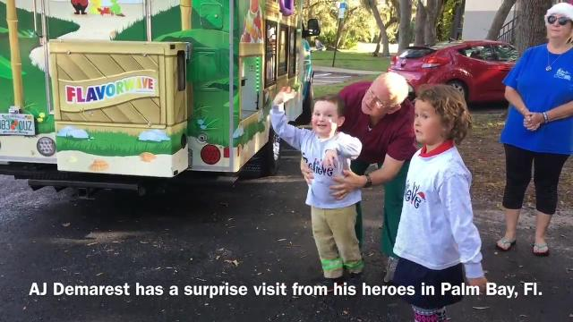 AJ Demarest, 4, is fighting multiple health issues and had fun filled visit from firefighters and Santa. Video by Riley Shortt and Tim Shortt. Posted 12/14/17.