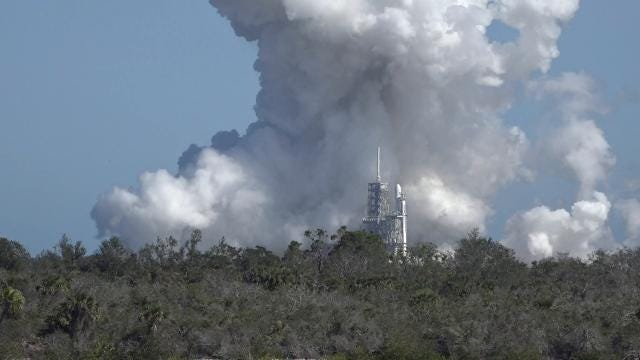 SpaceX test fired its three-core Falcon Heavy rocket at Kennedy Space Center's pad 39A for the first time on Wednesday, Jan. 24, 2018.