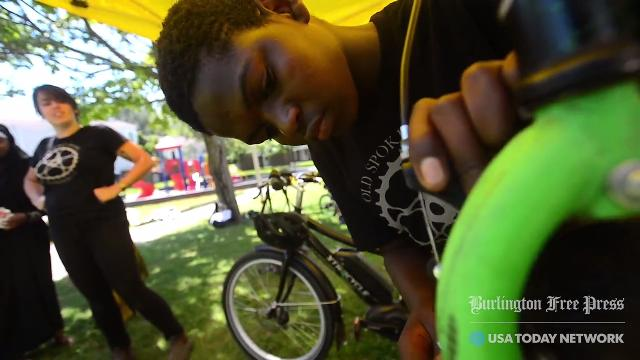Thanks to a partnership with Spectrum's Multicultural Youth Program, kids are being trained to fix bikes the right way and are working alongside the Old Spokes Home mobile repair unit to help fix bikes around Burlington that can't get to the shop.