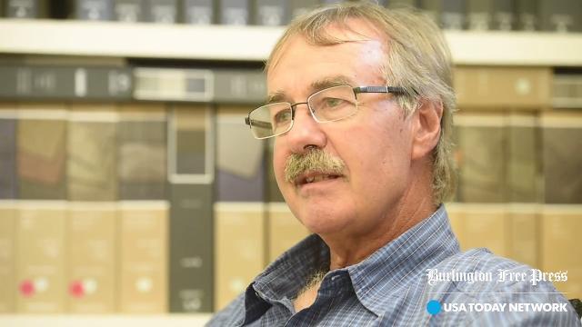 New England Floor Covering owner Nigel Mucklow says Burlington College still owes him $13,000.