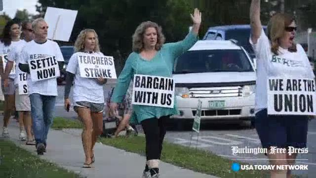 Striking Burlington teachers walk picket line
