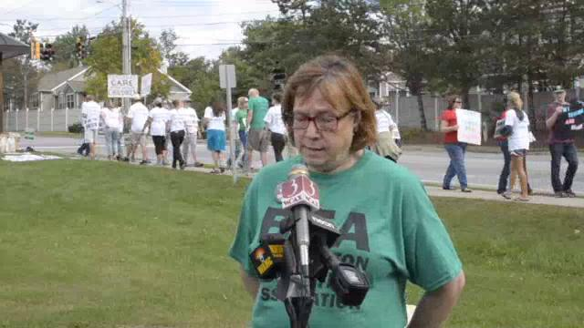 Fran Brock, president of the Burlington Education Association, the teachers union, speaks at a news conference as striking Burlington teachers walk a picket line outside the high school on Thursday, September 14, 2017.