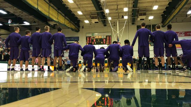 Some players and coaches on the St. Michael's College men's basketball team kneel during the national anthem before the game against University of Vermont on Saturday, Nov. 4, 2017, at UVM's Patrick Gym in Burlington.