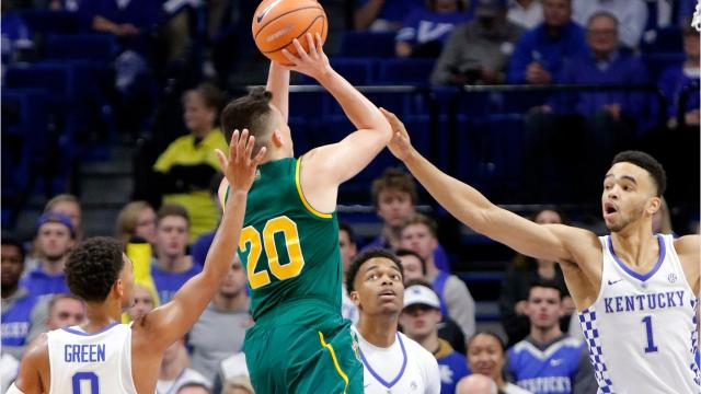 UVM falls to Kentucky 73-69 on Sunday in its season opener. Photos via USA Today and the Associated Press.