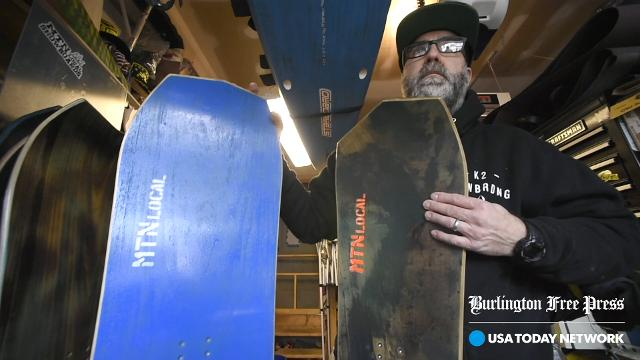 Max Holzman of MTN Local Snowboards makes custom boards out of wood at his shop in Essex Junction.