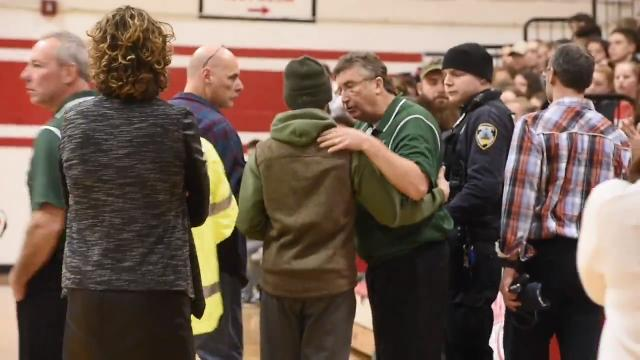Head coach Tim Rice, after collapsing during a girl's basketball game Monday night, Feb. 5, 2018, at CVU in Hinesburg, revives and later walks off the court with medical staff to applause.