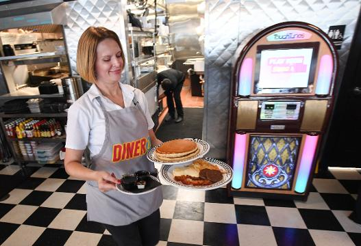 Diner 24 opens in downtown.