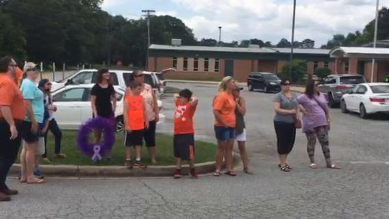 Children release balloons for Harper Edens and Hayden King