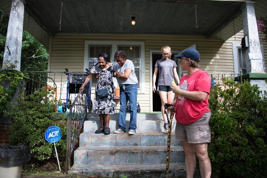 Church members from St. Anthony of Padua Catholic Church help 102-year-old Lois Jenkins move out of her home on North Leach Street after 80 years.