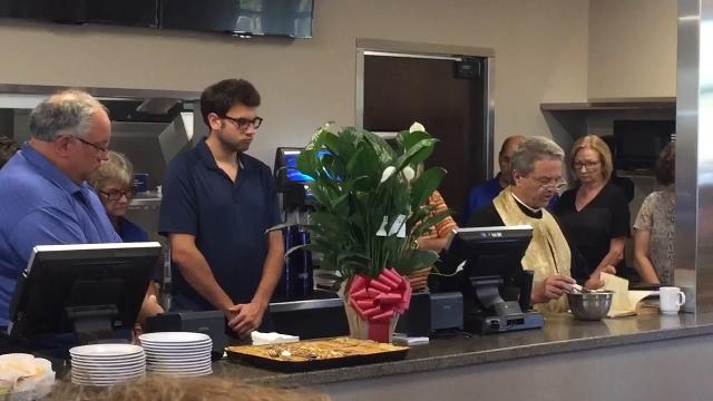 Father Tom Pistolis of St. George Greek Orthodox Cathedral blesses the new Carolina Drive In Restaurant.
