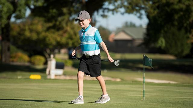 Jackson Meriss, 8, who has cerebral palsy, loves to play golf. He swings his club using only his left arm. He took up interest in the sport at an early age and now plays nearly every day with his father Todd and twin brother Caden.