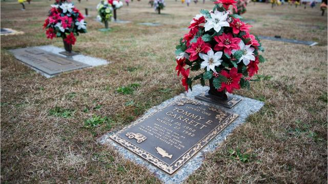 Michael Garrett of Simpsonville was delivering flowers to his loved ones at Cannon Memroail Park when he noticed an unexpected grave placed between his grandmother and father, where he was supposed to be buried. Now, the Garrett family are fighting the cemetery to move the grave, which they say interrupts their line of family graves that they bought in 1982.