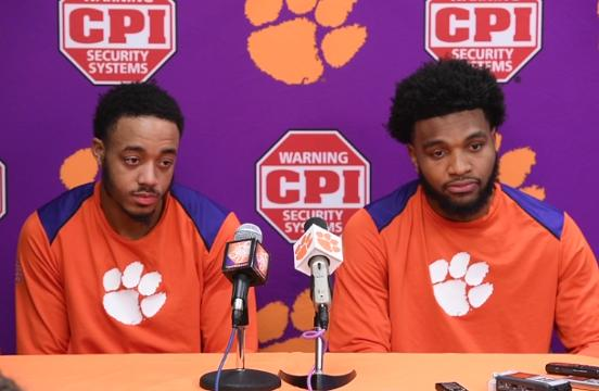 Clemson's Marcquise Reed and Gabe DeVoe after the Tigers after OT win over Louisville.