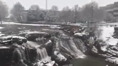 Snowfall shows a different side of Falls Park in downtown Greenville.