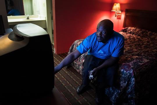 JC Wright moves back into a hotel down the street from the condemned Economy Inn where he was living before.