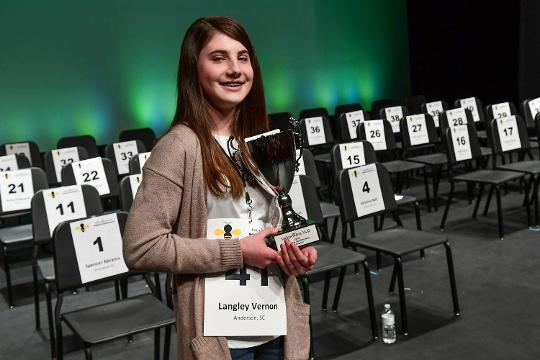 Langley Vernon, an eighth grader from Riverside Middle in Pendleton repeats as Spelling Bee champ in the Henderson Auditorium at Anderson University on Saturday, March 3, 2018.