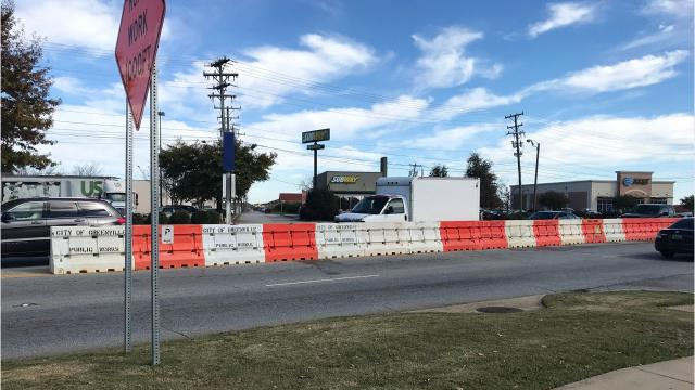 Barriers in place to limit left turns on Woodruff Road during the holiday season will soon become permanent.