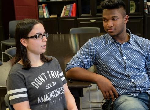 Westside seniors Gabriella Alicea, left, and Jonathan Bruce talk about how students are preparing to walk out on Wednesday to promote school safety, and remember institutions who were victimized by shootings.
