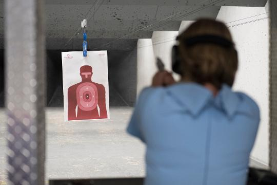 GOP Candidate Catherine Templeton does target practice during a campaign stop at Sharpshooters Gun Range and Club in Greenville.