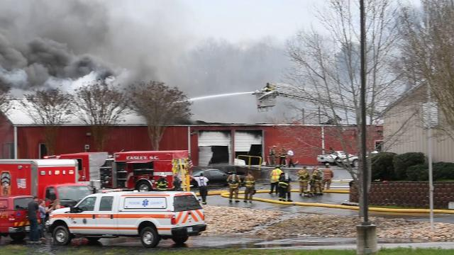 Firemen battle Hawks Motorsports fire in Easley on Tuesday, March 20, 2018.