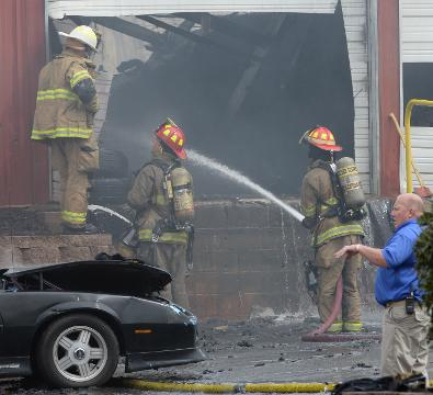 Owner Bruce Hawkins and Easley fire chief Butch Womack talk about the Hawk's Motorsports fire on S.C. 8 in Easley on Tuesday, March 20, 2018.