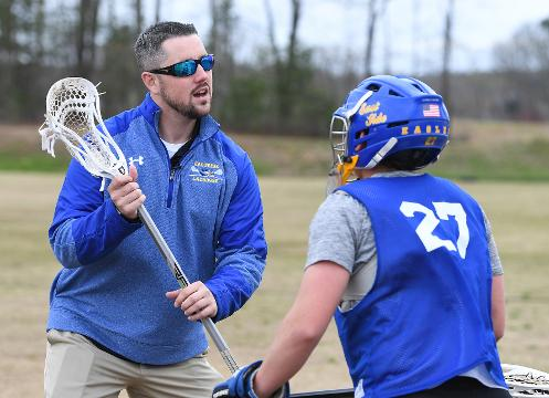 Eastside High School boys lacrosse coach Mike McCallan is back on the sidelines six months after brain surgery.