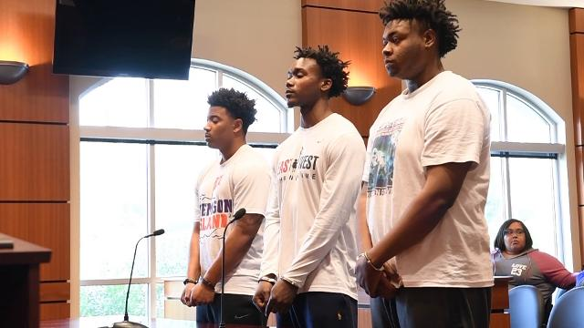 Charlie Bernard Fuller, left, Jadar Kentrell Johnson, middle, former Clemson football players,and Quaven Maurice Ferguson, former Duke football player, appear in Clemson Municipal Court in Clemson on Thursday.