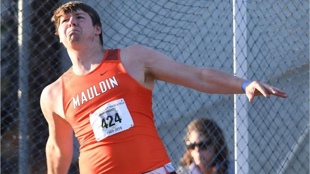 Mauldin's Logan Carroll set a meet record in the discus, highlighting the first day of events at the 50th Greenville County Track and Field Championships at Eastside High School.