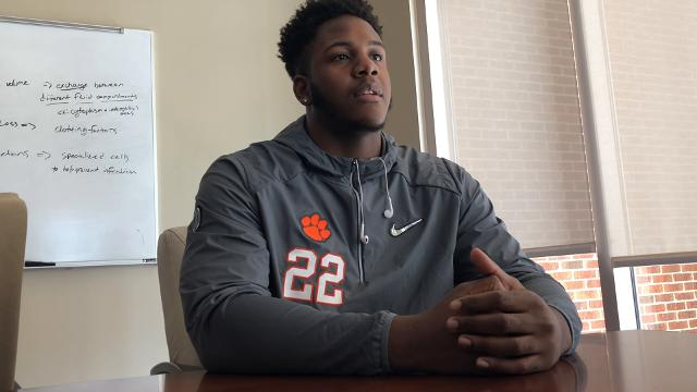 Clemson defensive end Xavier Kelly and Clemson Athletics' associate director of creative media, Jeff Kallin, reflect on Kelly's artistry and its impact on his peers.