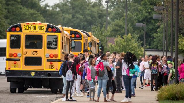 After canceling two days of classes to try to fix busing problems that plagued Muncie Community Schools on its first day, the city schools were back in session Monday morning.