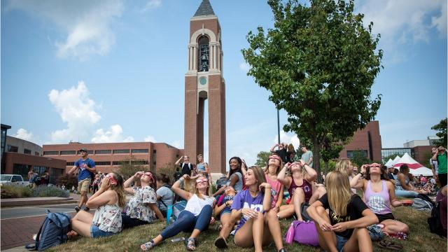 Over an estimated 1,500 students, staff and community members crowded the University Green just next to Shafer Tower on Ball State University's campus for an eclipse watch party.