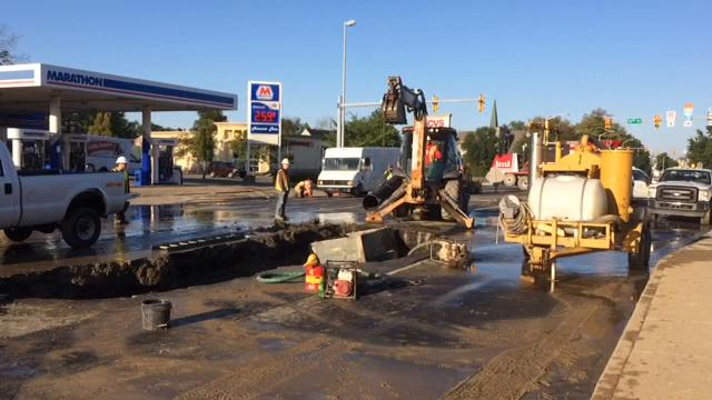 After working all night, crews have reached the water main break underneath the 1600 block of East Main Street. Materials were set out for the repairs.