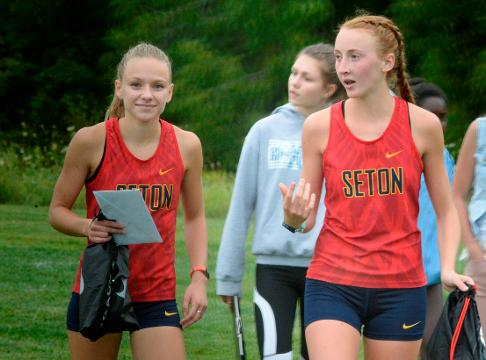 Seton Catholic's Jenna Barker celebrated her county title by handing out pizza. Hagerstown's Kaleb Slagle followed with unique handshakes.