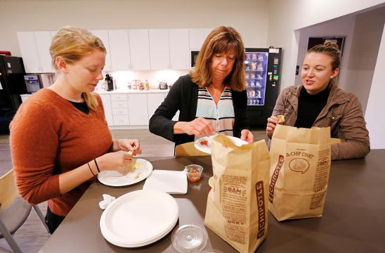Journal & Courier staffers Emma Ea Ambrose, from left, Carol Bangert and Meghan Holden sample Chipotle's new quest Thursday, September 14, 2017, at the J&C offices in Lafayette.