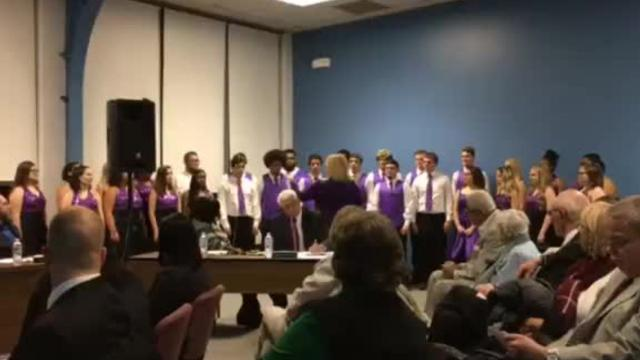"At MCS' most recent board meeting, Central High School's choir sings ""Carol of the Bells."""
