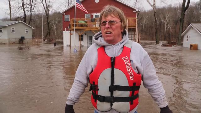 Dennis Kellar talks about the flooding along Horseshoe Bend Road Wednesday, February 21, 2018, near Brookston. Kellar said he may finally move after his house next to the Tippecanoe River has been flooded yet again