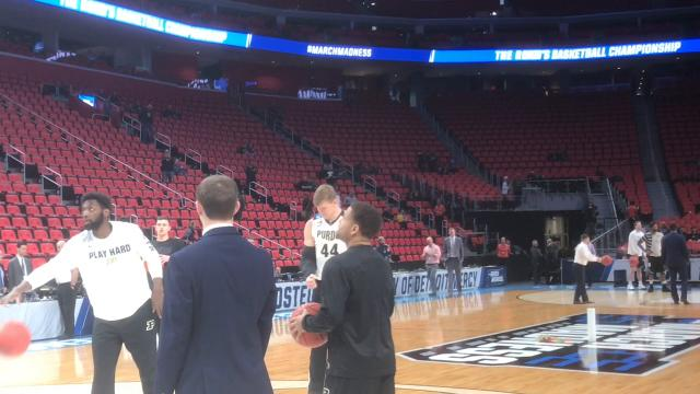The Boilermaker senior center tried to warm up prior to today's NCAA Tournament game against Butler wearing a large brace on his right arm.