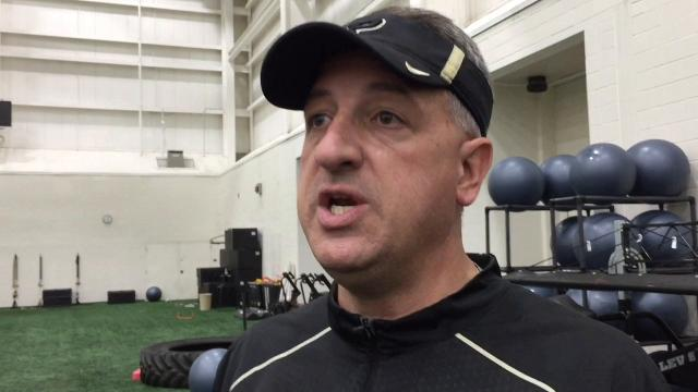 The program's offensive line coach evaluates his group after eight practices