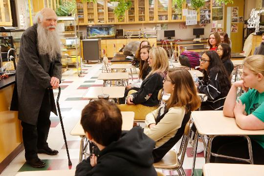 Biology teacher Joe Ruhl dresses in costume as Charles Darwin as he introduces his students to Darwin's study of evolution Thursday, April 19, 2018, at Lafayette Jeff.