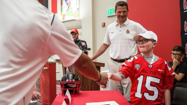 The nine-year-old makes several trips to Riley Hospital each month. He'll also be hanging around the Ball State football team.