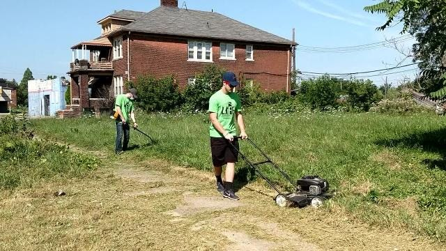About 120 people went to Detroit Wednesday and helped volunteer to clean up the area around Detroit Central High School.