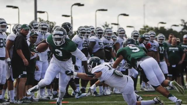 Lansing State Journal columnist Graham Couch and Detroit Free Press / LSJ MSU beat writer Chris Solari break down the latest happenings from MSU football practice, with highlights from the Friday, Aug. 4, 2017 practice in the background.