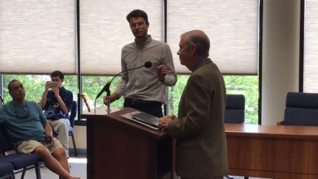 William Lawrence, of Lansing, was escorted from the room Monday after challenging U.S. Rep. Tim Walberg, R-Tipton, on climate change during a town hall-style meeting. Lawrence said he belongs to a group that wants to halt climate change.