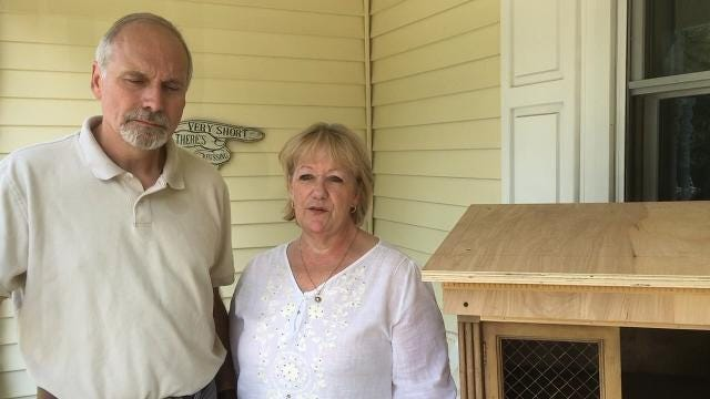 """Kim and Rick Klatt of Grand Ledge heard about """"little free pantries"""" from their daughter in Fayetteville, Arkansas.  The couple, with the cupboard they are working on, hope it takes off here."""