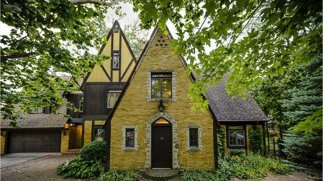 David and Robin Peters house in St. Johns, a massive English Tudor-style creation, is up for auction.