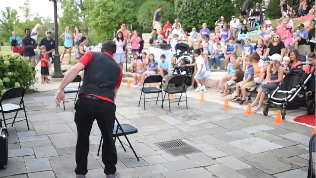 Juggler Crazy (Craig) Wise balances 80 lbs. of folding chairs on his face during a Wednesday morning performance in Novi, Michigan.