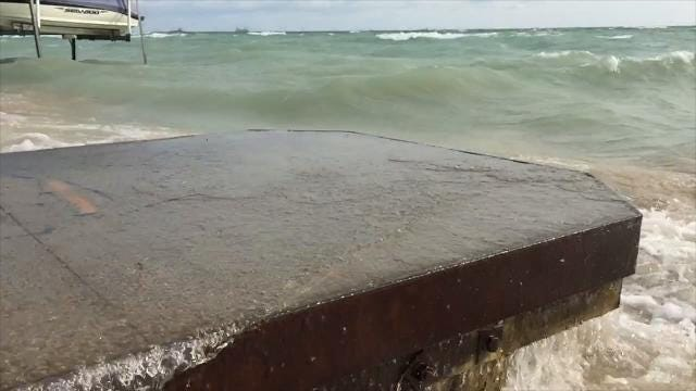 A north northeast wind pounded the Lake Huron shoreline with big waves on Thursday, Aug. 31, 2017.