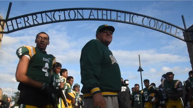 The archway leading to the football field at Farmington Harrison High School was dedicated Friday night to the only football head coach Harrison has ever had -- John Herrington.