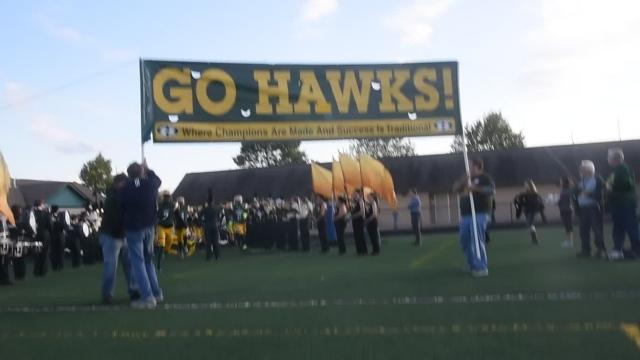 On a day honoring coach John Herrington by officially dedicating Herrington Athletic Complex the Hawks dominated the Cougars.