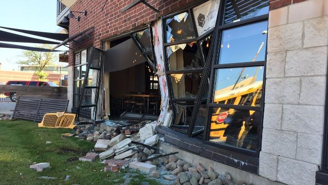 School bus crashes into building near downtown Lansing